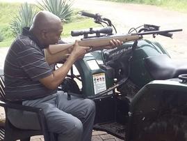 Zuma holding gun