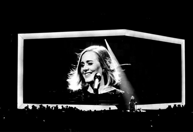 Adele calls fan on stage