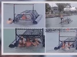 australian men swim with crocs