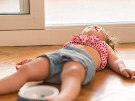 Toddler lying on the floor