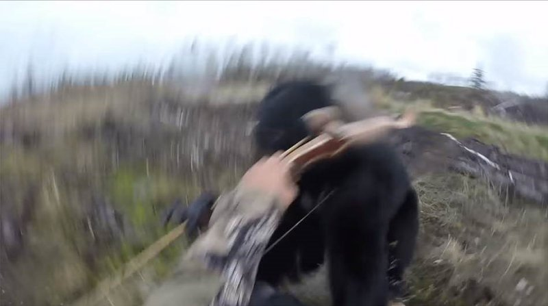 Hunter captures terrifying moment black bear charges at him