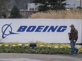 Boeing says to halt 737 MAX production next month