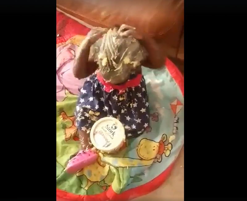 baby puts butter on herself