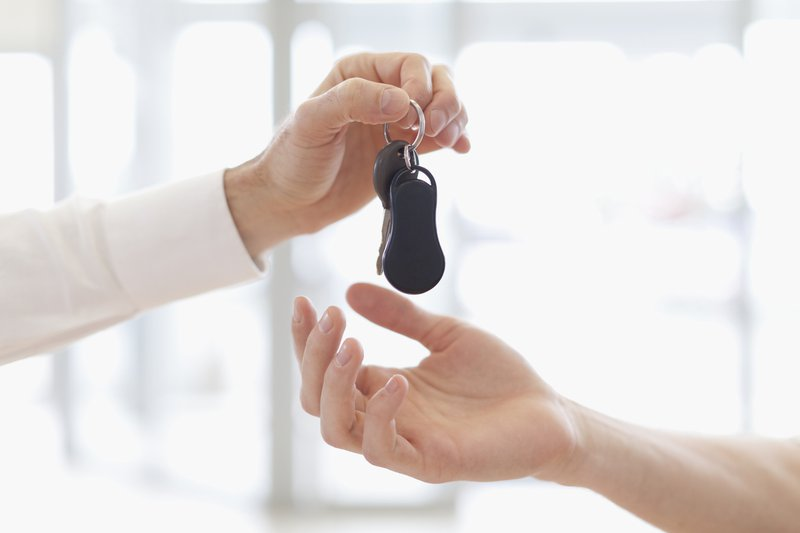 picture of a guy holding car keys