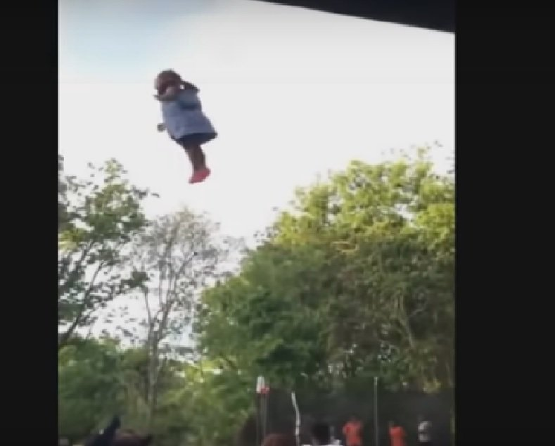 child thrown in the air
