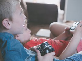 two boys play video games