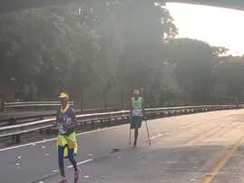 comrades runner on crutches