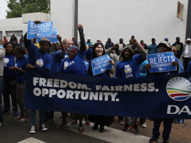 Democratic Alliance members protest outside court during coffin assault case