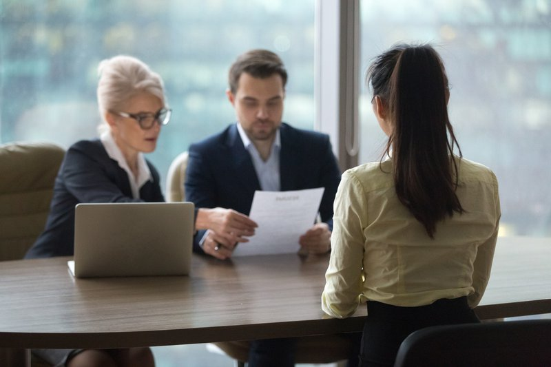 Female candidate interview with HR managers in office