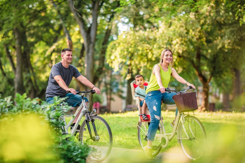 Father and mother with kid on bicycles