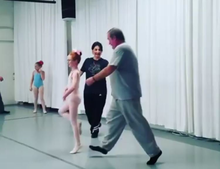 Dad's dancing with daughters