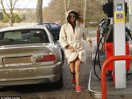 mother in morning gown at petrol station