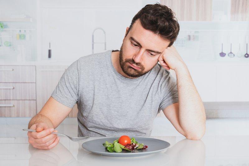 Sad man on a diet