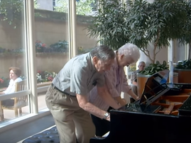 elderly couple piano duet
