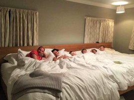 WATCH: Family of 6 co-sleeps and parents allow kids to choose their bedtime.