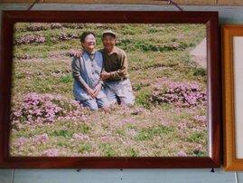 husband Toshiyuki Kuroki plants flowers for his blind wife Yasuko Kuroki