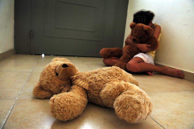 A girl holding a teddy bear