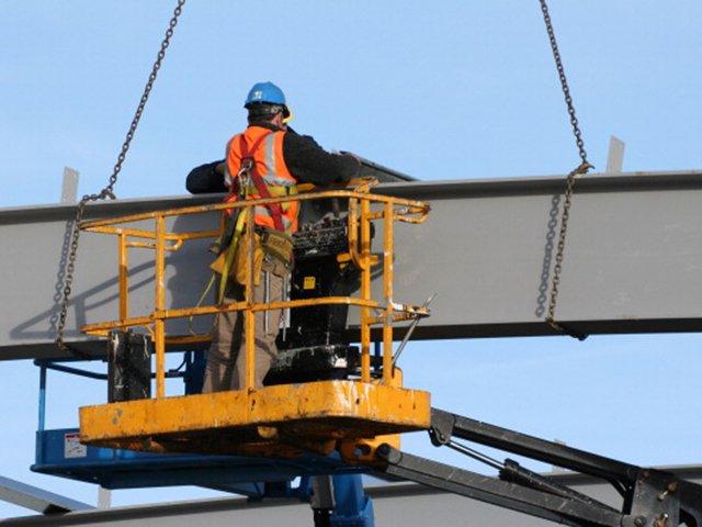 A man on a hydraulic lift