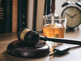 Law gavel, alcohol and car keys / iStock
