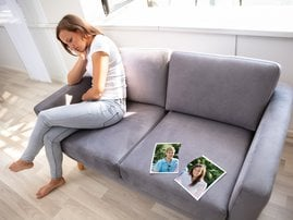 Lonely Woman Sitting On Sofa