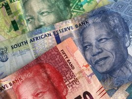 South African Rands notes stacked / iStock