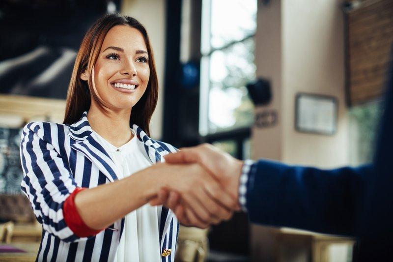 Businesswoman workplace handshake confidence