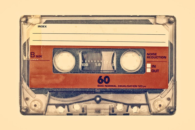 Retro styled image of an old compact cassette stock photo