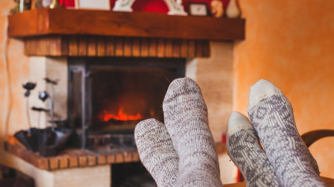 Cozy family evening near fireplace / iStock