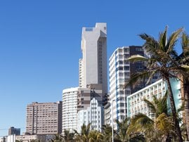 Buildings and Palm Trees on Golden Mile Beachfront / iStock