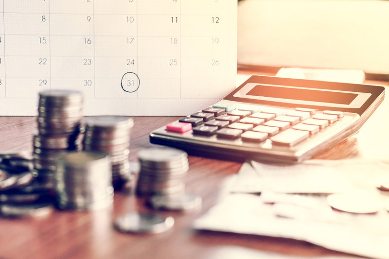 Budgeting With A Calculator Istock
