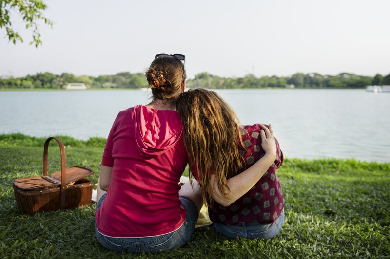 Mother and daughter having a picnic in the park / iStock