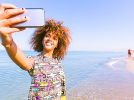 Woman travel phone selfie beach