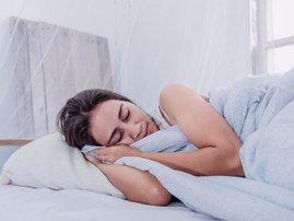 Woman sleeping mosquito net