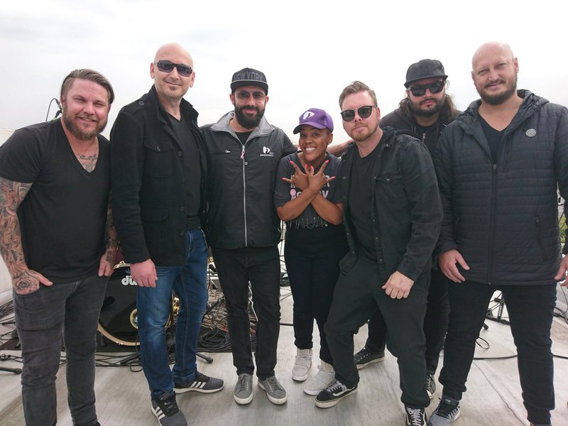 image martin and tumi with band on roof