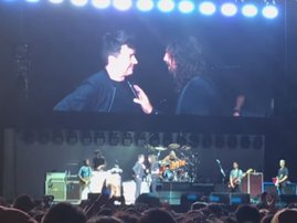 image rick astley and foo fighters on stage