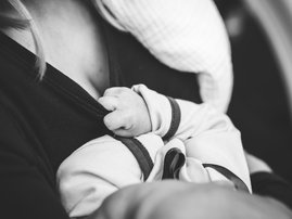 baby rested on mother's chest