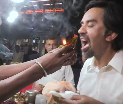 Man eating paan