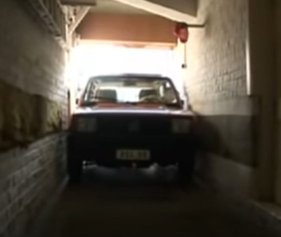 Man parks car in garage that is 6cm wider than his car...