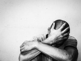 Depressed man with head bowed