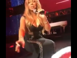 mariah sits on stage