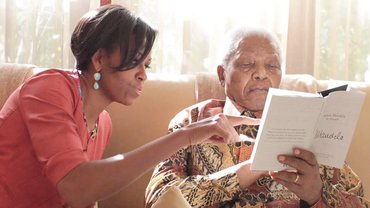 michelle obama and nelson mandela reading a book
