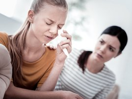 Mother comforting crying teenager