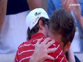Nicolas Mahut and his son hugging