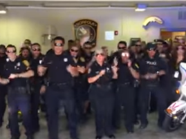 police officers dancing