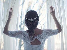 bride looking out window pexels