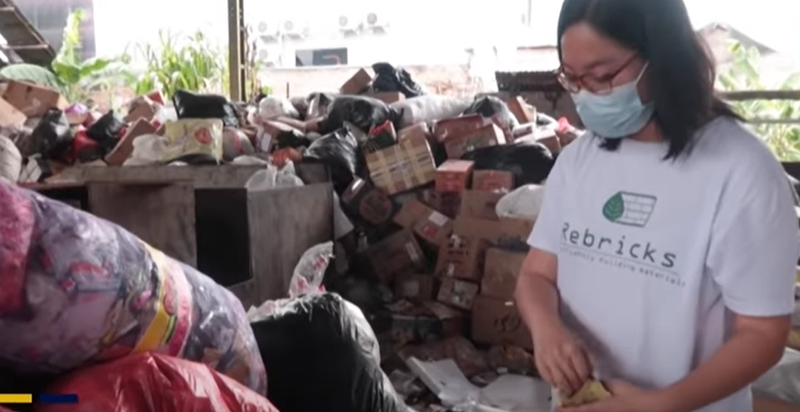 WATCH: An Indonesian woman is recycling waste plastic into construction bricks
