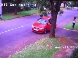 robbed lady red car image