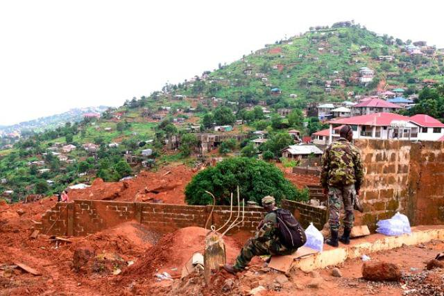 Threat looms of more mudslides in Sierra Leone amid burials