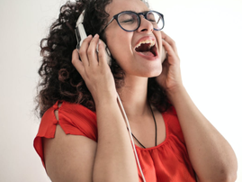 A woman singing wearing a red top with headphones 1