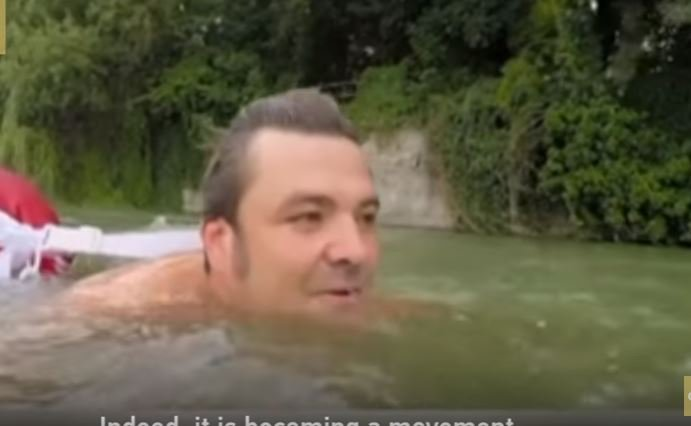 German man swims to work